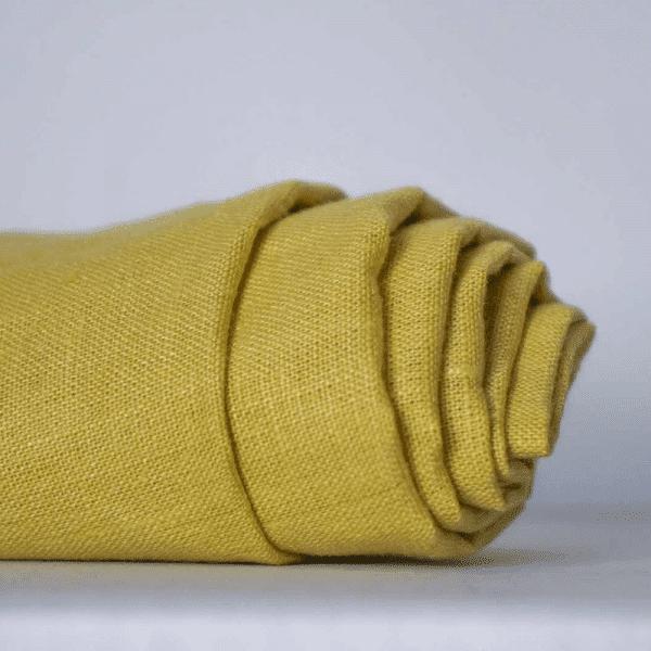 בד פשתן לבדגים, רקמה, וילונות ומפות שולחן בצבע צהוב